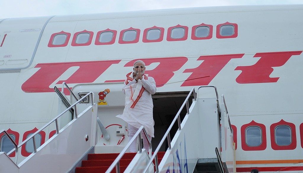 Prime Minister of India Narendra Modi offers a traditional greeting upon arriving in Astana on July 7.