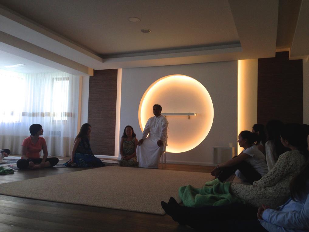 Over 20 yoga students gathered at yoga studio to meditate with Art of Living teacher Swami Brahmatej.